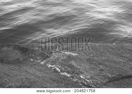 The textures of the surfaces of water and stone