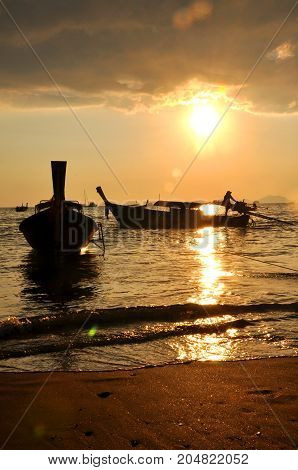 Fishermen's boats (Long tails) moored at the edge of the beach of Ao Nang (Thailand) in the early hours