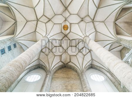 Salzburg Austria - August 4 2016: The pillars and Gothic voulted ceiling of the Franciscan church interior