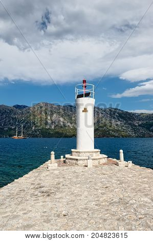 MONTENEGRO, PERAST - AUGUST 13, 2017: View of the lighthouse on the island of the Our Lady of the Rocks (Gospa od Skrpela Island)