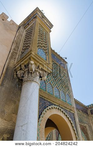 Famous Bab Mansour gate with elaborate decoration, pillars, and arches in arabic city of Meknes, Morocco, North Africa.