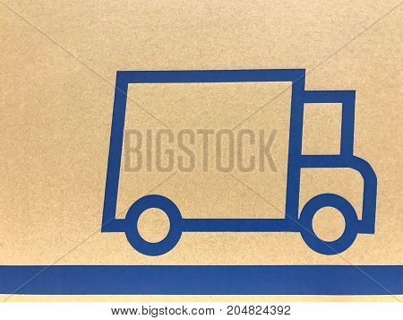 Symbol of truck on cardboard office home and transportation concept