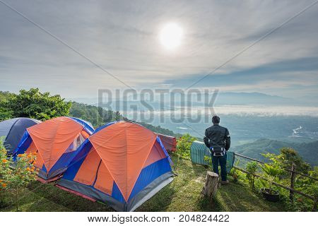 Tour tents camp on the mountain. View of morning mist and sun rise.