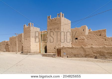 Beautiful old clay building called a kasbah in desert of Morocco, North Africa.