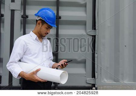 Engineer Check Construction Plan On Smartphone