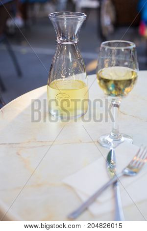 A glass of wine and white wine in a cafe on the table.