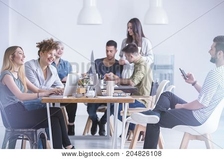 Friends Laughing While Working