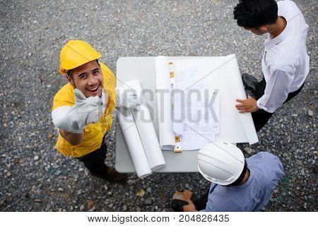 Engineering Team Look Paper Plans By Top View