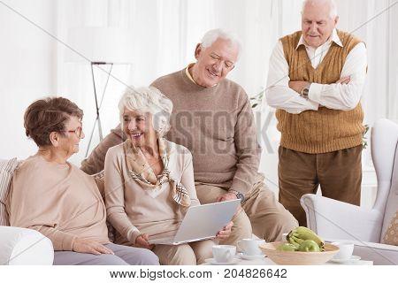 Elder Woman Uses Laptop