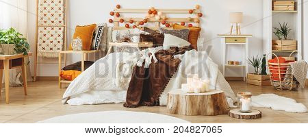 Autumn style in cozy bedroom with wood decoration