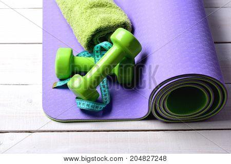 Dumbbells Made Of Green Plastic On Light Wooden Background
