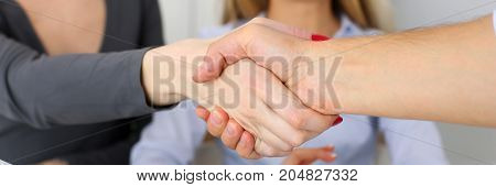 Business People Shake Hands As Hello In Office