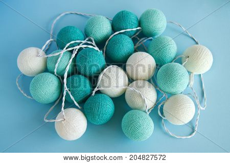 Blue And White Light Ball Made Of Yarn Threads Closeup On The Blue Background, Top View. Christmas D