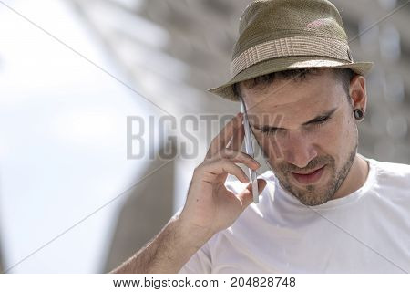 Portrait Of A Happy Businessman Walking Outdoors With Mobile Pho
