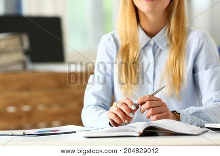 Female Arm In Suit Hold Silver Pen Making Note