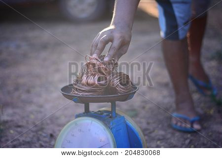 The Recycle Buyer Weighing The Copper Roll With Traditional Scales