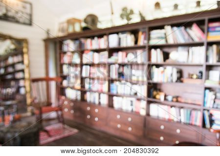 Blurred Abstract Background Of Retro Book On Ookshelf. Blurry Bookshelf In Library Room For  Backgro