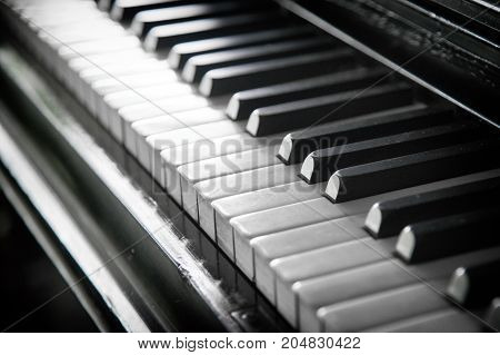 Piano keyboard background with selective focus.A row of piano keys in black and white.