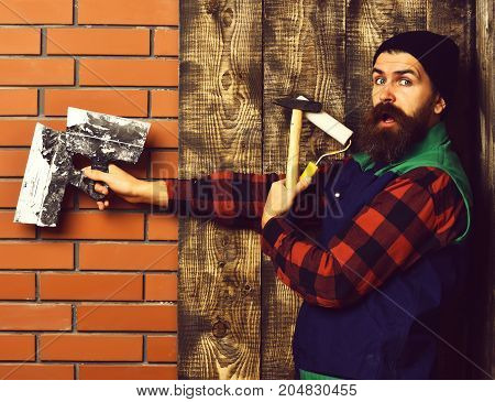 Bearded Foreman Holding Various Building Tools With Surprised Face
