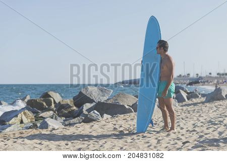 Surfer Holding His Blue Surfboard