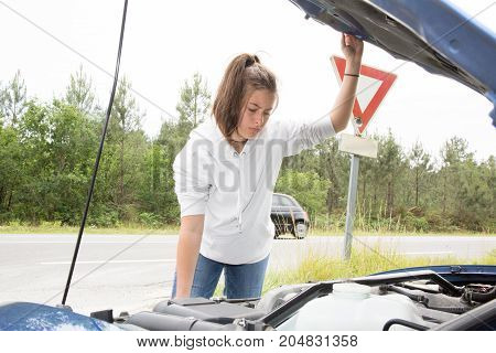 Woman Opened The Hood Broken Blue Car