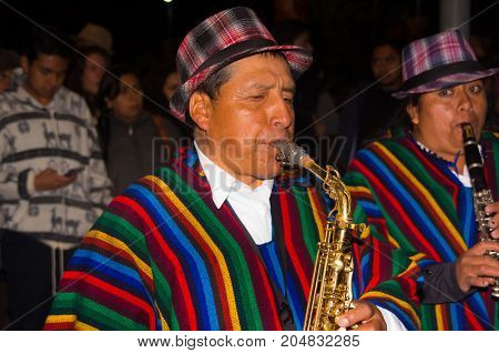 Quito, Ecuador - february 02, 2016: An unidentified people is playing his instrument during popular town celebrations.