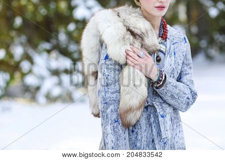 Young woman in winter park. Winter fashion concept