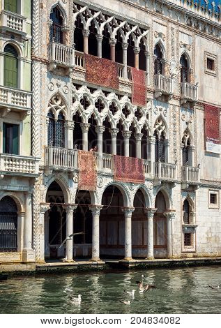 Venice, Italy - May 18, 2017: Ca' d'Oro palace on the Grand Canal. Ca' d'Oro (Palazzo Santa Sofia) is one of the older palaces in Venice.