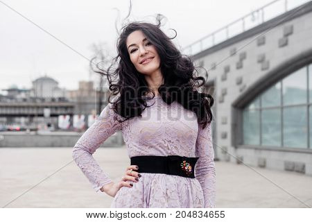 beautiful female portrait with hair blowing in the wind