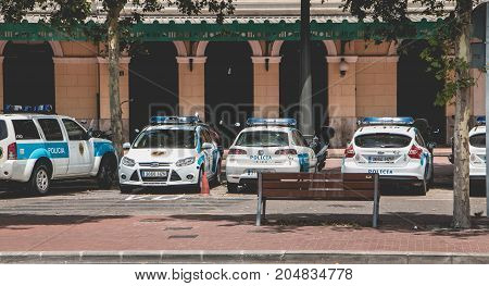 Police Cars Parked In Front Of A Police Station In The Center Of Valencia, Spain