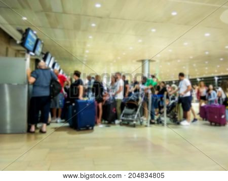 Blured view of the passengers at check in zone in departure hall of the international airport