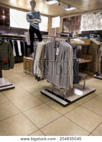 Blured view of interior of small fashion clothing store