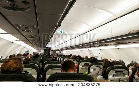 Prague Czech Republic - July 30 2017: Interior of modern commercial airplane with passengers on their seats waiting to take off.