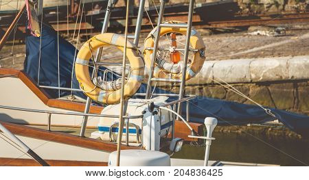Close Up On Sun-bleached Rescue Buoys