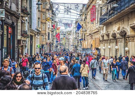 ISTANBUL, TURKEY : Crowds of people walking along Istiklal Avenue on October 6, 2014. Istiklal is one of the most famous avenues in Istanbul, visited by nearly 3 million people in a day