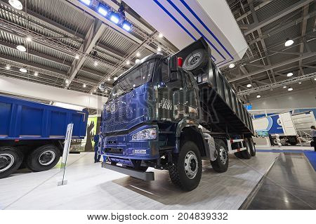 MOSCOW, SEP, 5, 2017: Close up view on Chinese FAW dump truck exhibit on Commercial Transport Exhibition ComTrans-2017. FAW commercial transport on exhibition stand Chinese commercial dump trucks cars