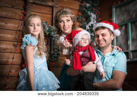 Family In The Room Before Christmas And New Year