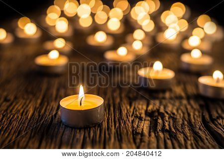 Candles Light In Advent.. Christmas Candles Burning At Night. Golden Light Of Candle Flame