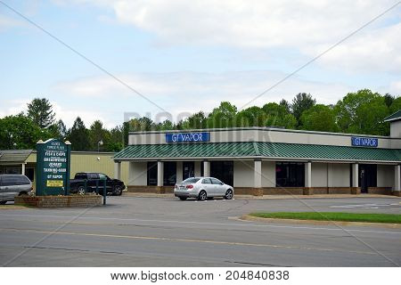 PETOSKEY, MICHIGAN / UNITED STATES - MAY 30, 2017: One may purchase electronic cigarettes at GT Vapor, in the Clock Tower Plaza, a strip mall conveniently located between Harbor Springs and Petoskey.