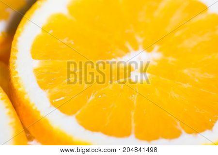 Orange background from slice of an orange fruit texture.