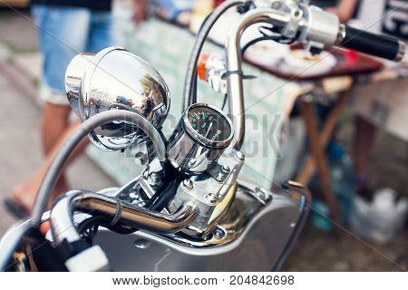 chrome wheel and motorcycle speedometer. retro transport