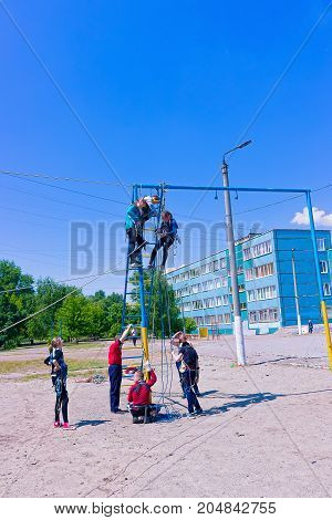 Kyiv, Ukraine - May 21, 2017: The girl as athletes training for climbing on the schoolyard at Kyiv, Ukraine on May 21, 2017