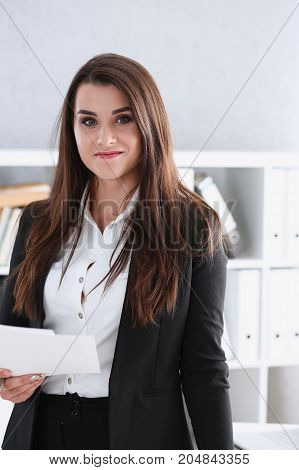 Beautiful Smiling Cheerful Girl At Workplace Look In Camera