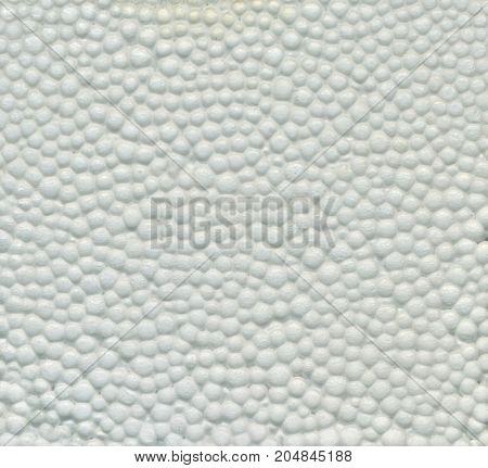 White Styrofoam Texture. White styrofoam balls background. Close shot. Safe packaging for fragile items. Detailed background of white styrofoam material