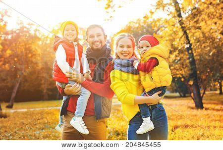 happy family mother father and children on an autumn walk in park