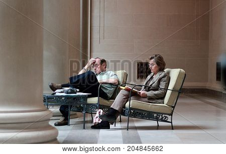 Washington DC - May 1, 2011: Middle aged couple taking rest in National Gallery of Art in Washington DC