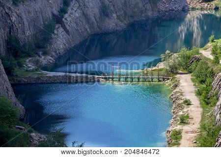 Blue lagoon at the bottom of Areat Amerika canyon, Czech Republic.