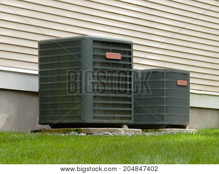 Heating and air conditioning units in back of an apartment complex