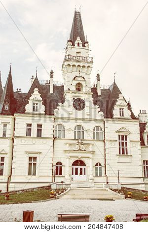 Beautiful Budmerice castle in Slovak republic. Architectural theme. Cultural heritage. Vertical composition. Travel destination. Yellow photo filter.