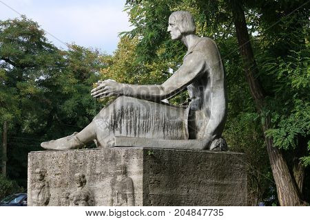 MAGDEBURG, GERMANY - September 19, 2017: This monument is reminiscent of Eike-von-Repgow, who is the author of the first German law book, the Sachsenspiegel. The book was written between 1220 & 1230.